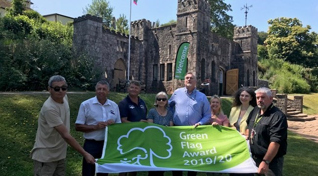 Councillors, volunteers and partners with the Green Flag at Homeyards Botanical Gardens in Shaldon.
